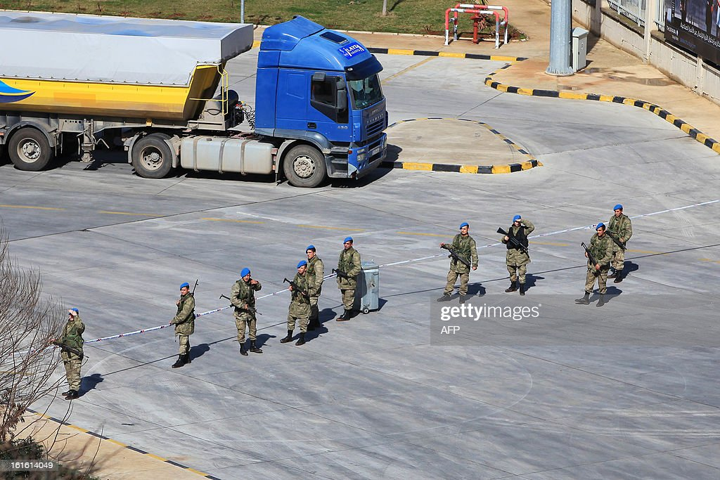 Turkish soldiers stand guard on February 13, 2013 at the Cilvegozu border crossing, where a vehicle exploded on February 11 in the buffer zone between Turkey and Syria's Bab al-Hawa post, which was seized by Syrian rebels in July. Fourteen people died in the blast.