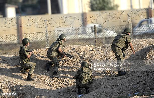 Turkish soldiers take position near the Akcakale crossing gate between Turkey and Syria at Akcakale in Sanliurfa province on June 15 2015 Kurdish...