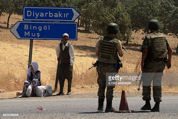Turkish soldiers wait at a check point in Diyarbakir on July 26 2015 following the death of two Turkish soldiers A car bomb attack killed two Turkish...