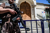 A Turkish special force police officer stands guard in front of the French Consulate on the Istiklal avenue in central Istanbul on July 15 following...