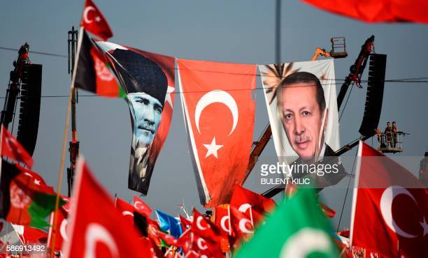 Turkish special force police officers stand guard next to a banner picturing Mustafa Kemal Ataturk and Turkish President Recep Tayyip Erdogan as...