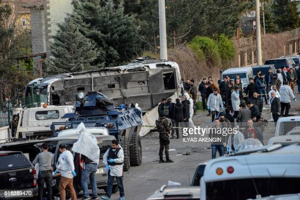 TOPSHOT Turkish special force police officers walk at the site of a bomb attack in Diyarbakir southeastern Turkey on March 31 2016 Four police...