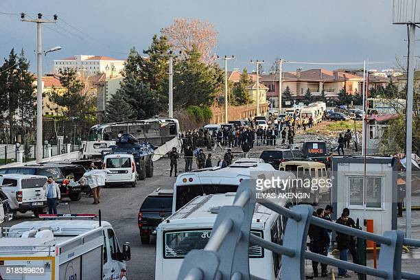 Turkish special force police officers walk at the site of a bomb attack in Diyarbakir southeastern Turkey on March 31 2016 Four police officers were...