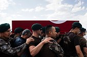 TOPSHOT Turkish special forces policemen carry the coffin of the officer Meric Alemdar killed during the failed July 15 coup attempt at a funeral...