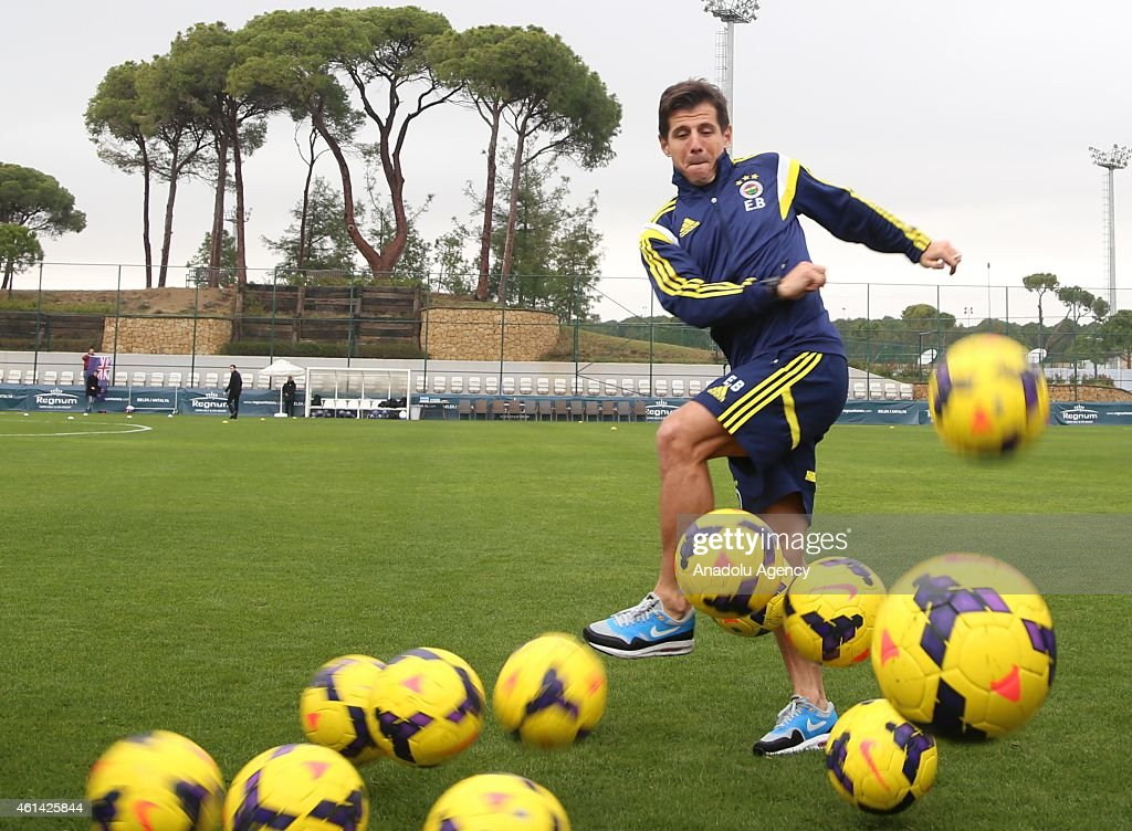 Turkish Spor Toto Super League's soccer team Fenerbahce's captain <a gi-track='captionPersonalityLinkClicked' href=/galleries/search?phrase=Emre+Belozoglu&family=editorial&specificpeople=649491 ng-click='$event.stopPropagation()'>Emre Belozoglu</a> poses as the footballs shot toward him after a press release during his team's ongoing training camp in Turkey's southern touristic seaside city Antalya on Jannuary 12, 2015.