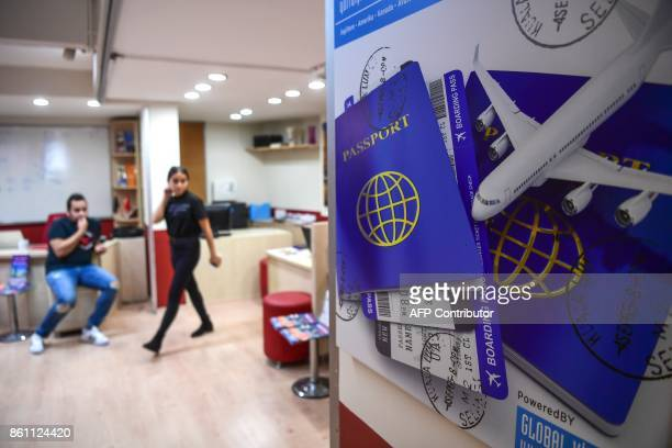 Turkish students are pictured at an education travel agency in Istanbul on October 11 2017 Turkish students business executives and travel operators...