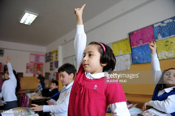 Turkish students attend a lesson at their school in Istanbul on March 23 2012 Education reforms which would allow parents to put their children in...