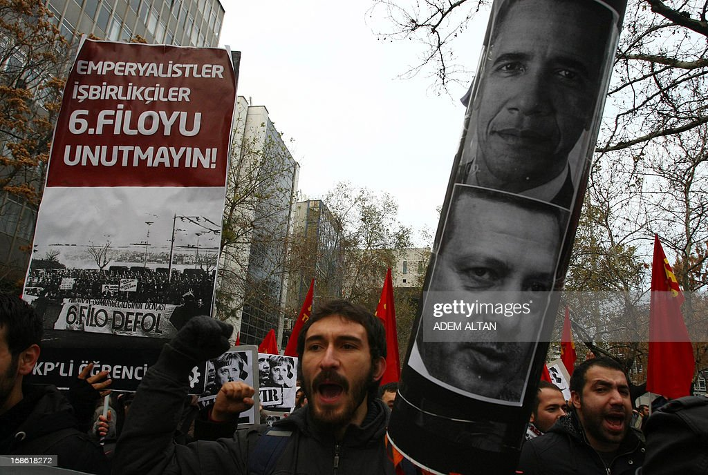 Turkish students hold a poster with photos of Turkish Prime Minister Recep Tayyip Erdogan (bottom R), US President Barack Obama (top) during a protest against the Turkish government and NATO's deployment of patriot missiles near the Turkey-Syria border on December 21, 2012 in Ankara.