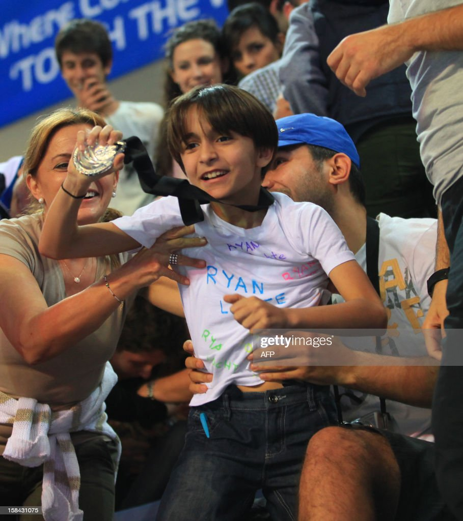 Turkish supporter Taha Aksu celebrates after US swimmer Ryan Lochte won the gold medal in the 100 m individual medley during the Short Course Swimming World Championships in Istanbul on December 16, 2012.