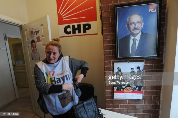 Turkish supporter Tülay Bozkurt of the 'no' campaign in Turkey's April 16 referendum to expand the powers of President Recep Tayyip Erdogan puts on a...
