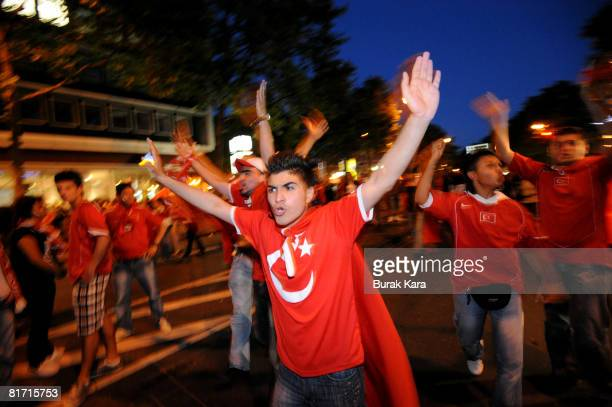 Turkish supporters react after they watched the UEFA EURO 2008 semi final match between Germany and Turkey at the KoelnArena on June 25 2008 in...