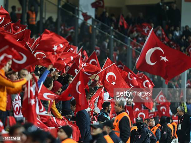 Turkish supporters wave flags during an international friendly soccer match between Greece and Turkey November 17 2015 in Istanbul Turkey