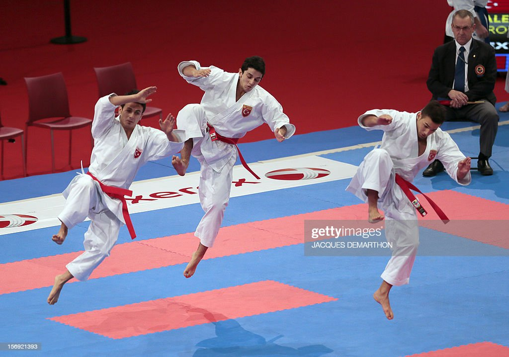 Turkish team members practice on November 25, 2012 before the men's team kata semi-finals against France of the Karate world championships at the POPB stadium in Paris. AFP PHOTO / JACQUES DEMARTHON
