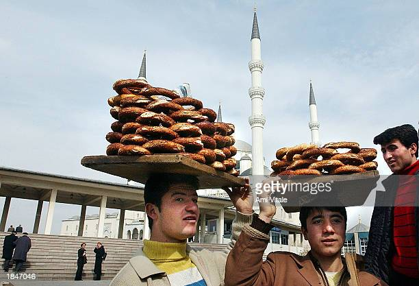 Turkish teens sell bread outside the main mosque March 13 2003 in Ankara the capital of Turkey The Turkish parliament will meet this weekend for a...