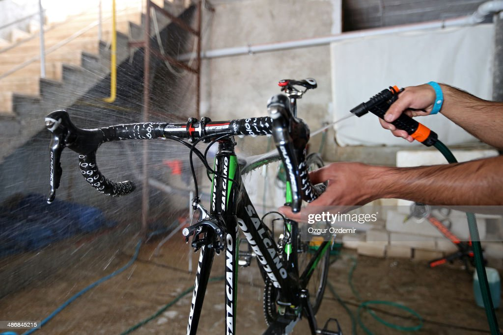Turkish Torku Sekerspor team technician washes a bike prior to the 50th Presidential Cycling Tour at Alanya in the Mediterranean resort city of Antalya on April 26, 2014 in Antalya, Turkey. The Presidential Cycling Tour of Turkey will be held between April 27 and May 4.