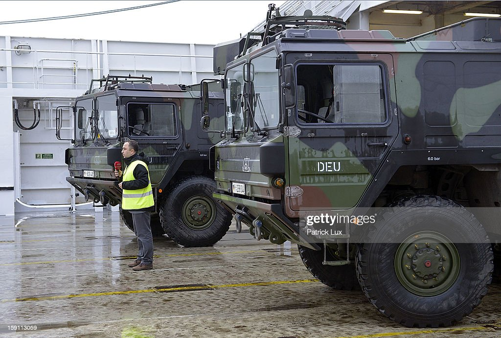 A turkish TV journalist speaks between parts of a Patriot anti-missile system to be loaded onto a ship for transport to Turkey by Bundeswehr, Germany's armed forces, on January 8, 2013 in Travemuende, Germany. Germany is deploying two Patriot batteries and 400 troops as part of a NATO operation that also involves Dutch and U.S. Patriot units to defend Turkey from possible Syrian attack.