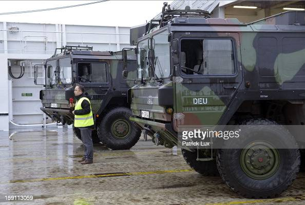 A turkish TV journalist speaks between parts of a Patriot antimissile system to be loaded onto a ship for transport to Turkey by Bundeswehr Germany's...