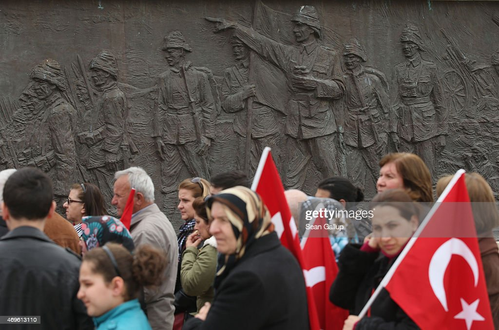 Turkish visitors holding flags walk past a relief at the Turkish 57th Infantry Regiment Memorial that shows Mustafa Kemal, then an Ottoman division commander and later founder of the modern Turkish Republic, leading an attack during the Gallipoli campaign on April 5, 2015 near Eceabat, Turkey. Allied and Turkish representatives, as well as family members of those who served, will commemorate the 100th anniversary of the campaign with ceremonies scheduled for April 24-25. The Gallipoli land campaign, in which a combined Allied force of British, French, Australian, New Zealand and Indian troops sought to occupy the Gallipoli peninsula and the strategic Dardanelles strait, began on April 25, 1915 against forces of the Ottoman Empire. The Allies, unable to advance more than a few kilometers, withdrew after eight months. The campaign cost the Allies approximately 45,000 killed and up to 200,000 wounded, the Ottomans approximately 85,000 killed and 160,000 wounded.