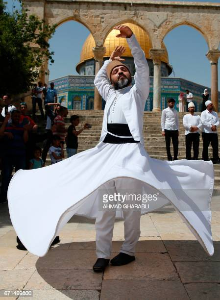 A Turkish whirling dervish performs outside the Dome of the Rock at the AlAqsa mosque compound in Jerusalem on April 22 during a ceremony...