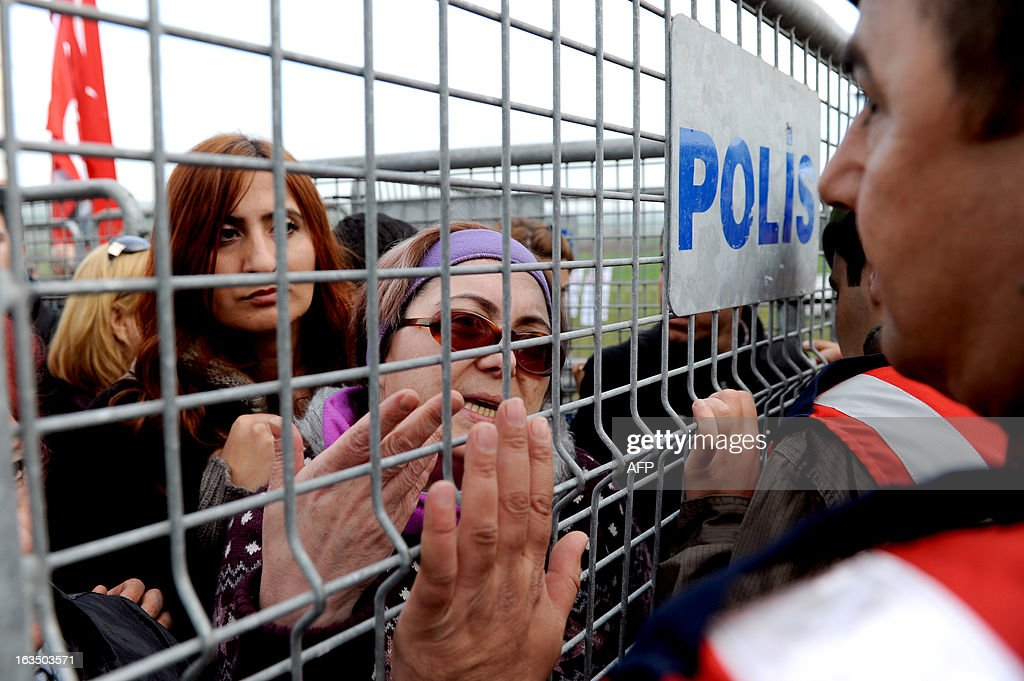 A Turkish woman argues with gendarmerie behind barricades in Silivri near Istanbul on March 11, 2013 where prosecutors are scheduled to deliver their final arguments in the case against 275 people accused of plotting to overturn the Islamic-leaning government. A verdict in the four-year long case involving 275 defendants, including Turkey's former military chief Ilker Basbug and other army officers as well as lawyers, academics and journalists, is expected in the coming weeks. The defendants face dozens of charges, ranging from membership in an underground 'terrorist organisation' known as Ergenekon and instigating an armed uprising against Erdogan and his Justice and Development Party (AKP), which came to power in 2002.