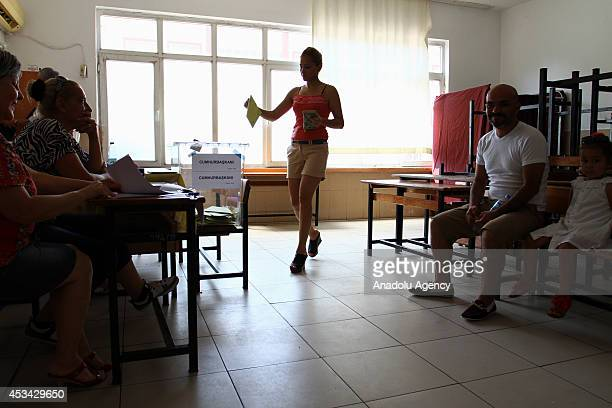 Turkish woman casts her ballot in the Turkey's presidential election at a polling station in Mersin Turkey on August 10 2014 Millions of Turkish...