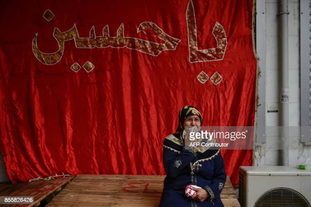 A Turkish woman cries as she takes part in a religious procession held for the Shiite religious holiday of Ashura on September 30 in Istanbul Ashura...