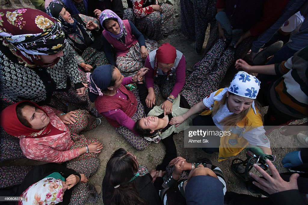 Turkish woman faints during the funeral of the the miners after a mining disaster on May 15 2014 in Soma a district in Turkey's western province of...