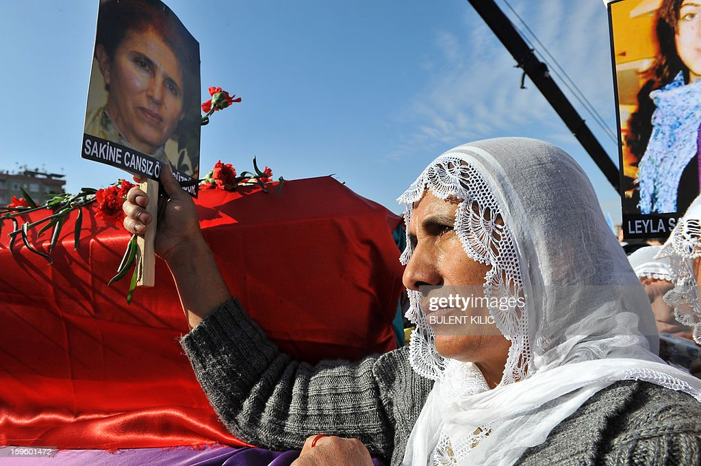 A Turkish woman holds a portait of Sakine Cansiz upon the arrival of the coffins of the three top Kurdish activists, Sakine Cansiz, Fidan Dogan and Leyla Soylemez, shot dead in the French capital, on January 17 in Diyarbakir. Several thousand Kurds gathered Thursday in a square in Diyarbakir, the main city of Turkey's Kurd-majority southeast, to pay a final tribute to three Kurdish women activists who were assassinated in Paris last week. The growing crowd of participants, men and women adorned in white scarves, a symbol of peace, marched in a funeral many in Turkey feared would turn into a violent protest. The three women, one of them Sakine Cansiz, a co-founder of the outlawed Kurdistan Workers' Party (PKK), were found fatally shot, at least three times in their heads, at a Kurdish centre in Paris last week. French police were hunting the unknown assailants.