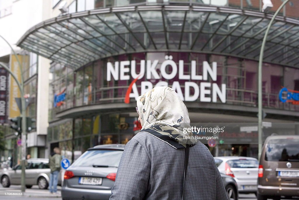 Turkish woman in front of the shopping mall Neukoelln-Arcaden in the district Neukoelln on May 27, 2013 in Berlin, Germany.