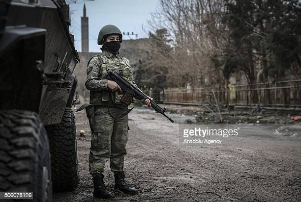 Turkish woman soldier patrols at a street as Turkish Security Forces carry out a counter terrorism operation against terrorist organization PKK in...