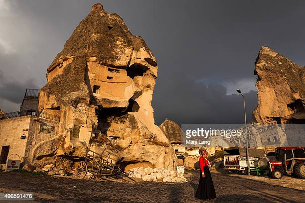 Turkish woman walking through the streets of Göreme a traditional village with fairy chimneys in the heart of Cappadocia Turkey