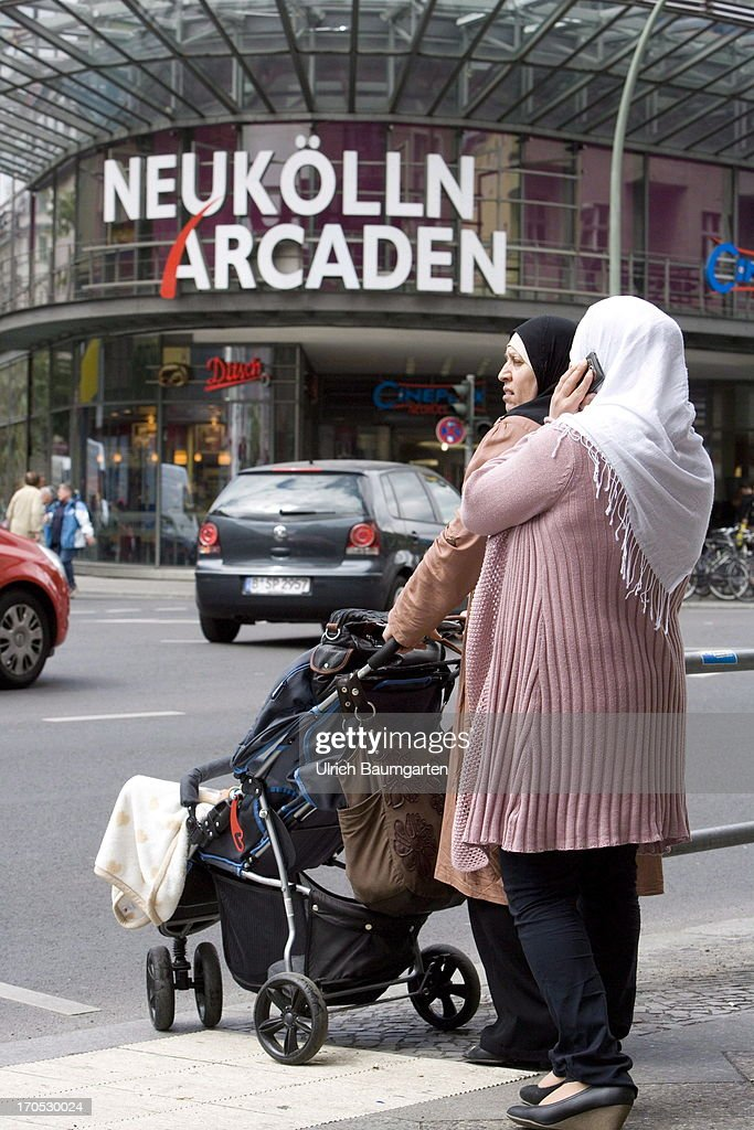 Turkish women in front of the shopping mall Neukoelln-Arcaden in the district Neukoelln on May 27, 2013 in Berlin, Germany.