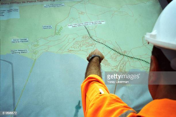 Turkish worker shows on a map the planning of the BTC's final terminal of the pipeline September 2003 near Yumurtalik Turkey For 27 years crude oil...