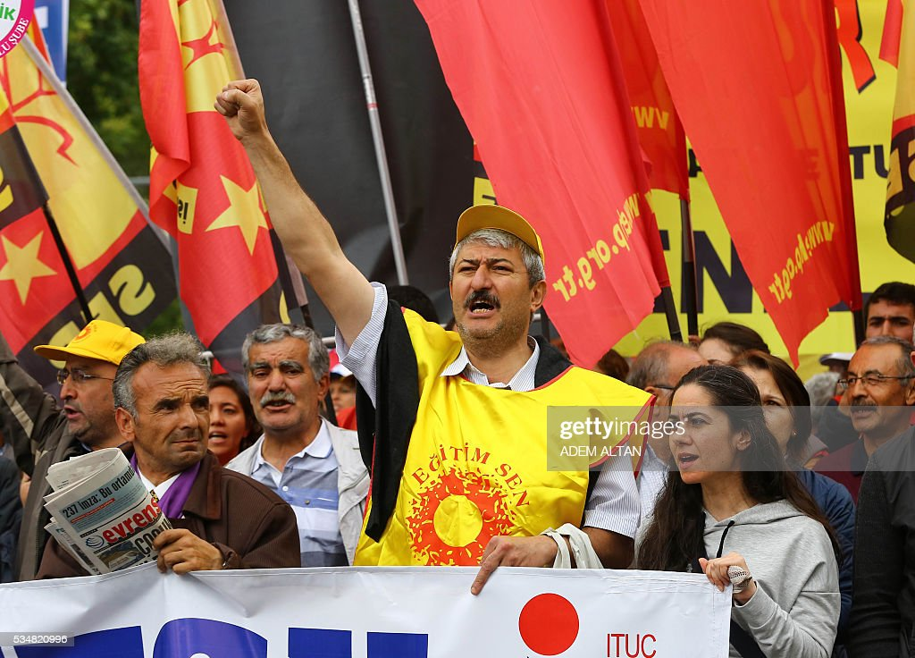 Turkish worker union members gesture during an anti-government, pro-secularism protest on May 28, 2016 in Ankara. Turkish President Recep Tayyip Erdogan on MAy 22 gave his close ally and Transport Minister Binali Yildirim the mandate to form a government as prime minister in a move set to further consolidate the strongman's grip on power. Yildirim is only the third party chairman in the history of the AKP -- which has transformed Turkey by putting Islam at the forefront of the officially secular country's politics -- after Erdogan and Davutoglu. / AFP / ADEM