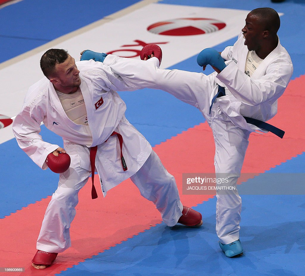 Turkish Yavuz Karamollaoglu (L) fights against Congo's Davy Diego Mez (R) during their men's bronze medal bout in the under 84 kg category at the Karate world championships on November 24, 2012 in Paris. aramollaoglu won the bout.