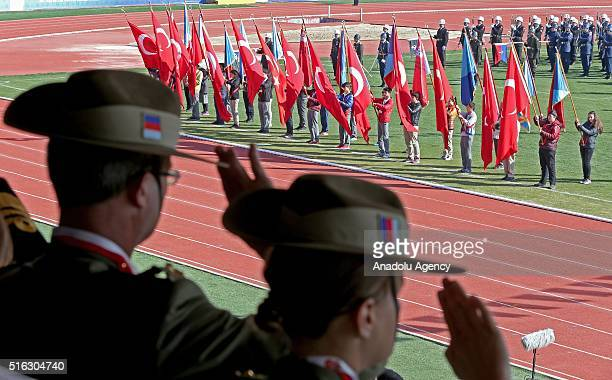 Turkish youths hold flags during the 101st anniversary of Battle of Canakkale in Canakkale Turkey on March 18 2016