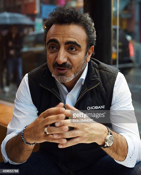 TurkishAmerican Hamdi Ulukaya founder and CEO of Chobani answers questions during an interview November 17 2014 in New York Chobani has become the...