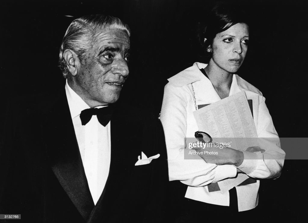 Turkish-born shipping billionaire Aristotle Onassis (1906 - 1975) and his daughter, American-born shipping heiress Christina Onassis (1950 - 1988), walk to gether as they attend an unidentified formal event, 1970s.