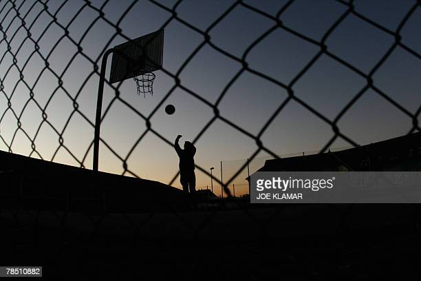 A TurkishKurdish boy plays a ball in central refugee's detention camp in eastern Slovak city of Secovce on 28 November where he waits for an asylum...