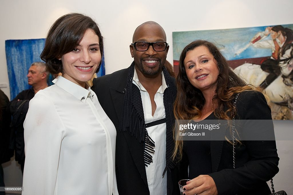 Turkist Actress Belcim Bilgin, Chaz Guest and guest pose for a photo at the 'Visions Of Mexico' International Retrospective at Quinn Studios on October 25, 2013 in Santa Monica, California.