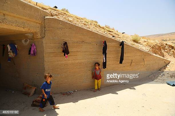 Turkmen families fled Tal Afar seized by armed groups led by Islamic State of Iraq and the Levant try to live under difficult conditions in Sinjar...