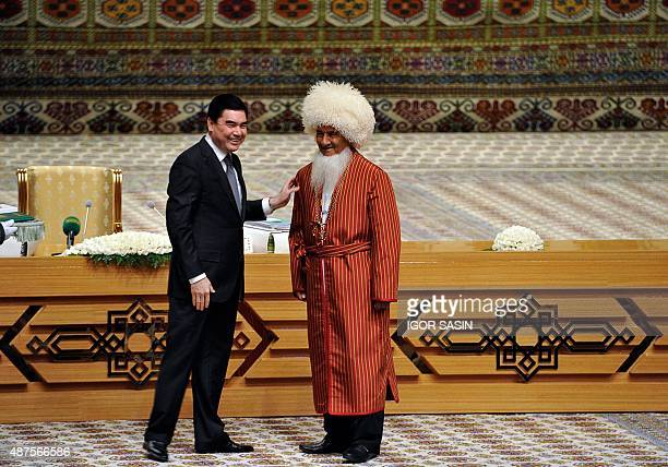 Turkmen President Gurbanguly Berdymukhamedov greets a delegate of Turkmenistan's council of fathers during a congress in the Turkmenistan's Caspian...