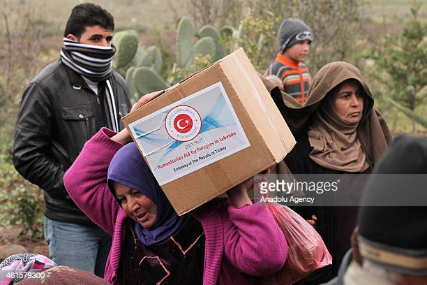 Turkmen refugees fled from the unrest in Syria to Akkar district in north Beirut Lebanon receive humanitarian aid from the Turkish Cooperation and...