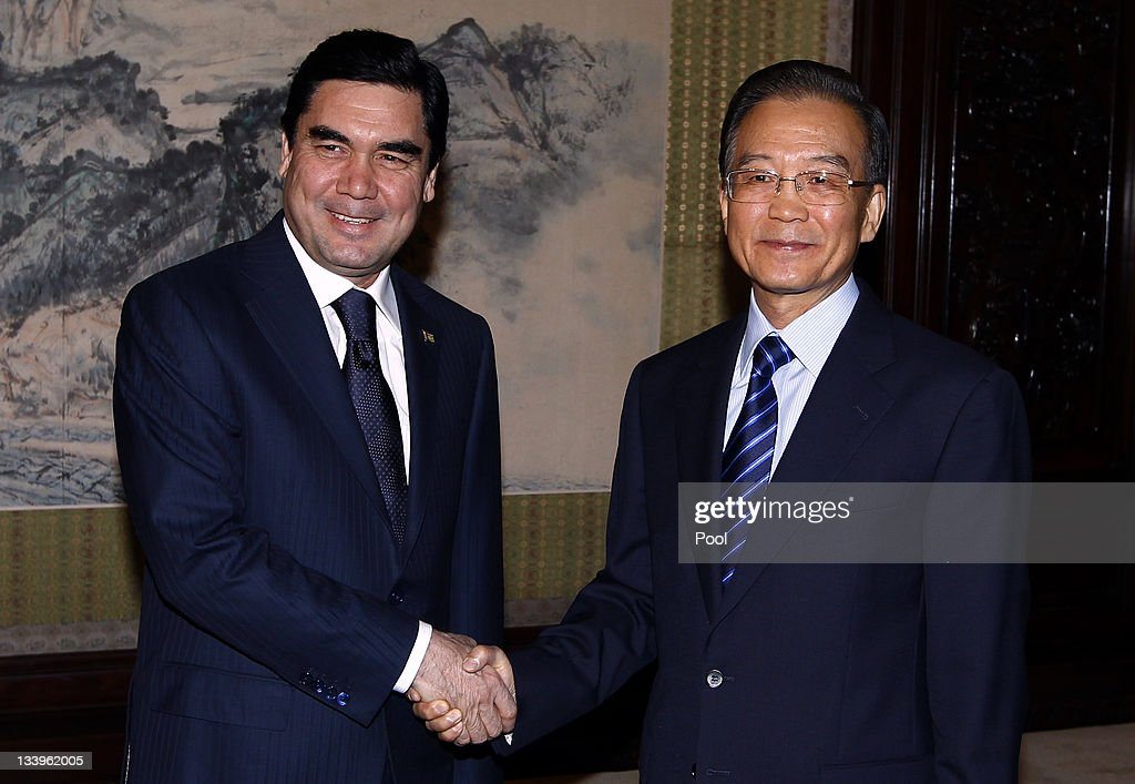 Turkmenistan President Kurbanguly Berdymukhamedov (L) shakes hands with Chinese premier <a gi-track='captionPersonalityLinkClicked' href=/galleries/search?phrase=Wen+Jiabao&family=editorial&specificpeople=204598 ng-click='$event.stopPropagation()'>Wen Jiabao</a> November 23, 2011 in Beijing, China. Berdymukhamedov, on an official visit from November 22 to 25, is in Beijing in the wake Turkmenistan's agreement to increase the supply of natural gas to China by 25 billion cubic metres.