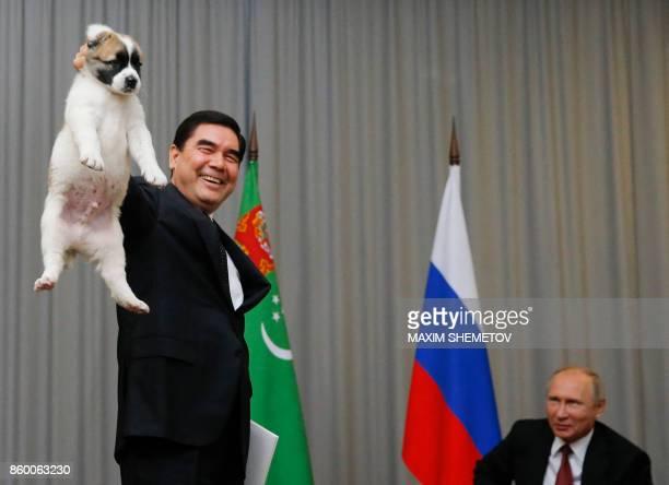 Turkmenistan's President Gurbanguly Berdimuhamedov presents a Turkmen shepherd dog locally known as Alabai to his Russian counterpart Vladimir Putin...