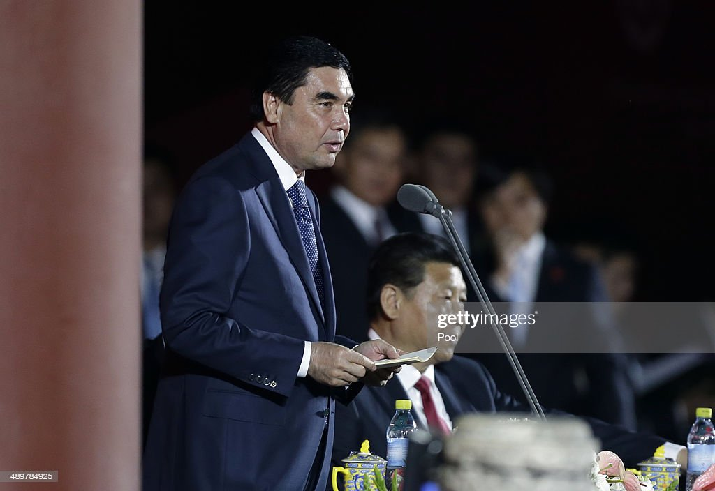 Turkmenistan's President Gurbanguly Berdimuhamedov (L) speaks next to China's President <a gi-track='captionPersonalityLinkClicked' href=/galleries/search?phrase=Xi+Jinping&family=editorial&specificpeople=2598986 ng-click='$event.stopPropagation()'>Xi Jinping</a> during the opening ceremony of 2014 International Akhal-Take Horses Association Special Conference and China Horse Culture Festival May 12, 2014 at Forbidden City, in Beijing,China.