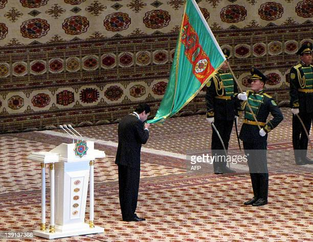 Turkmenistan's President Gurbanguly Berdymukhamedov kisses the national flag as he is inaugurated for a second term in the capital Ashgabat on...