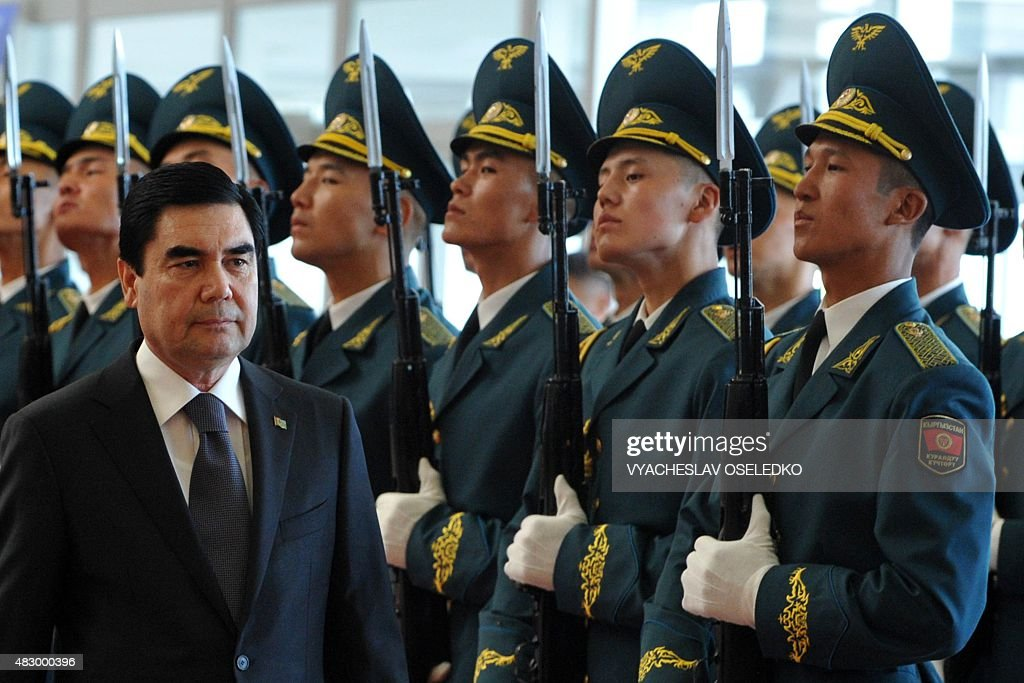 Turkmenistan's President Gurbanguly Berdymukhamedov reviews an honour guard during an official welcoming ceremony at Manas' airport 30 km from...