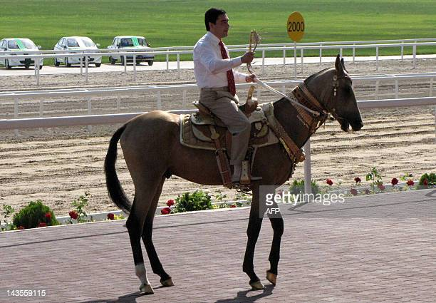 Turkmenistan's President Gurbanguly Berdymukhamedov rides a horse as he attends the Day of the Turkmen Race Horse holiday in Ashgabad on April 29...