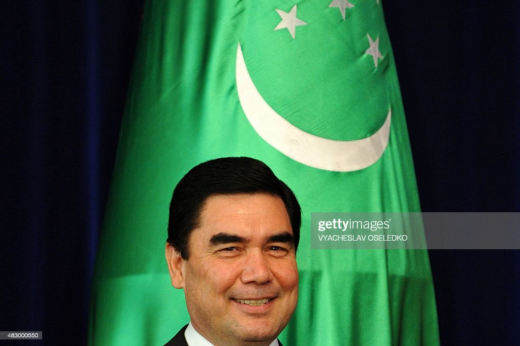 Turkmenistan's President Gurbanguly Berdymukhamedov smiles during a signing ceremony at the Ala-Archa state residence in Bishkek on August 5, 2015.